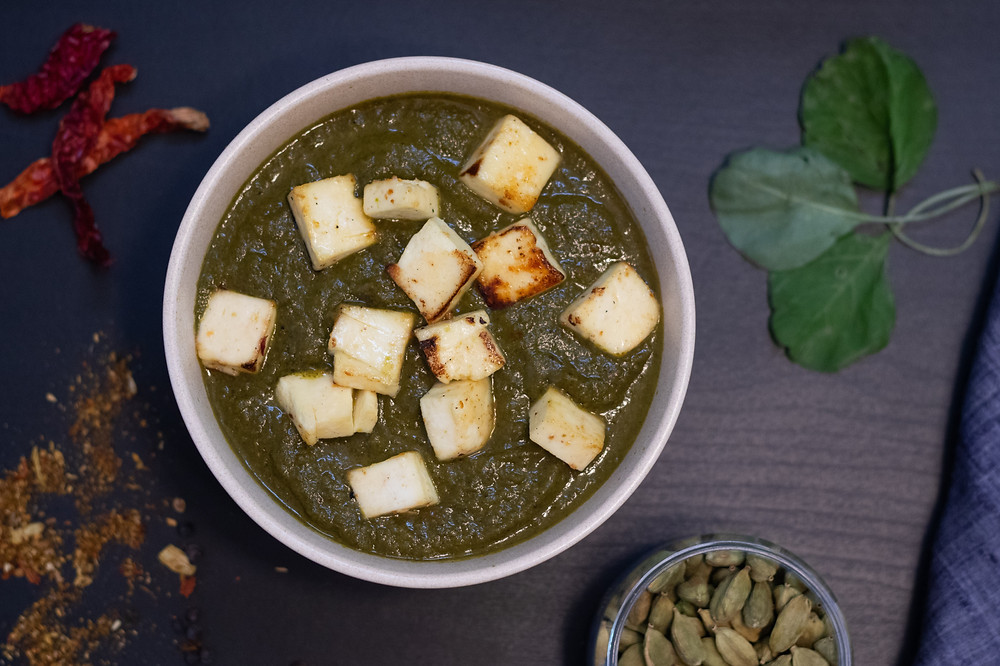 This is a picture of Saag paneer in a bowl
