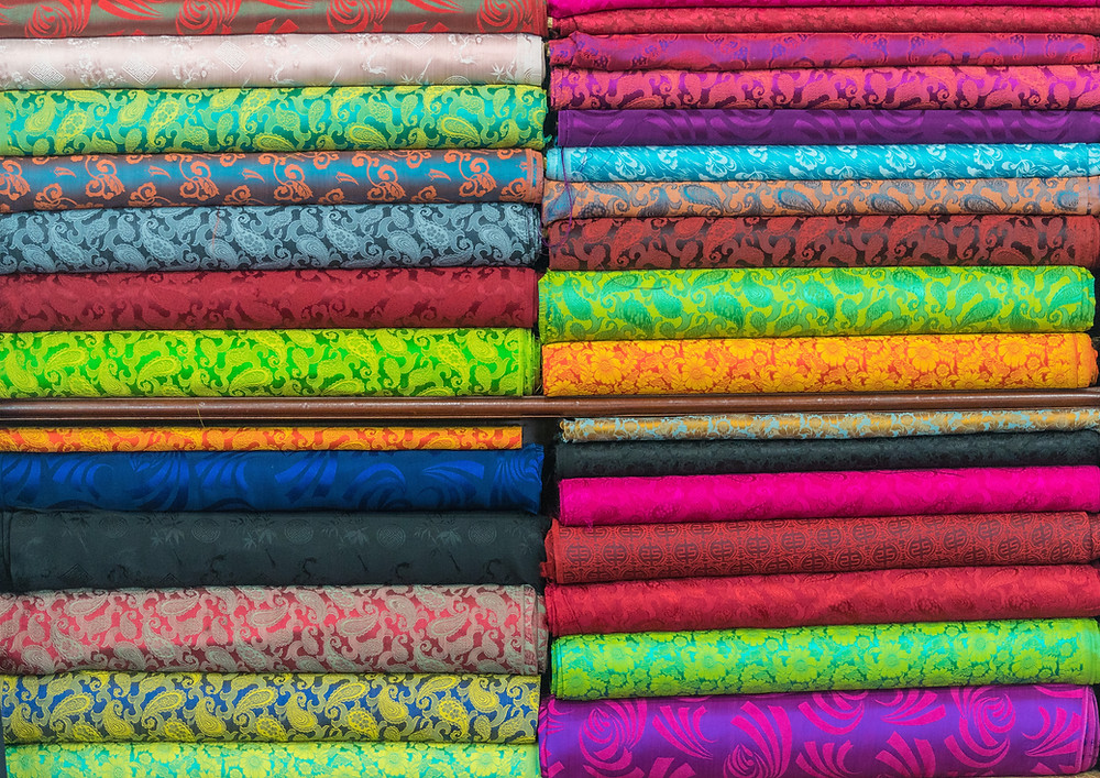 stacks of different colour fabrics