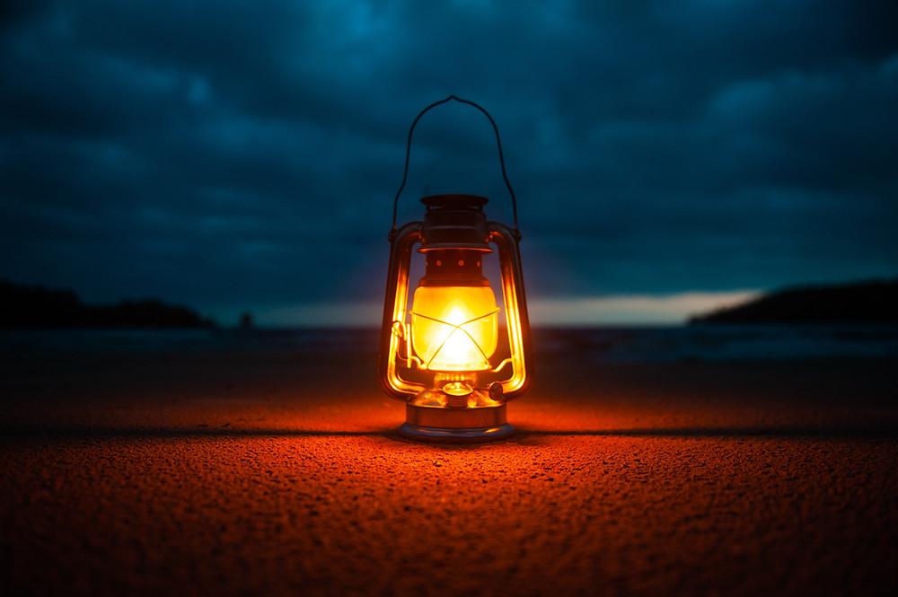 dark sky illuminated gently by a lamp