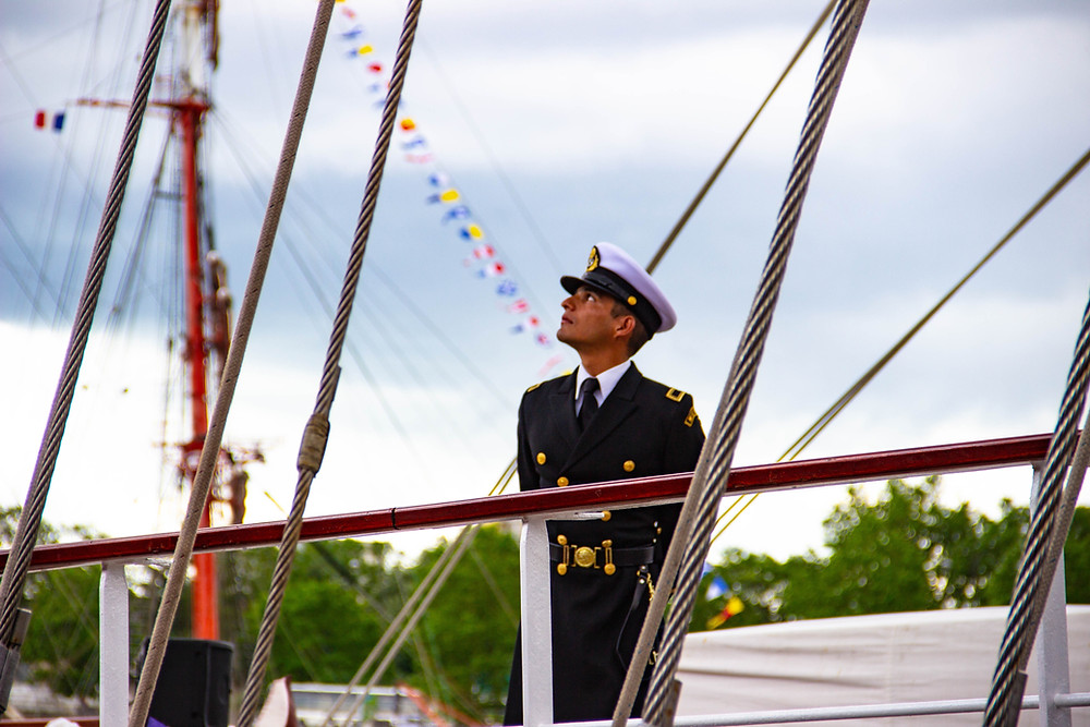 Naval Officer looking aloft onboard a tall ship.