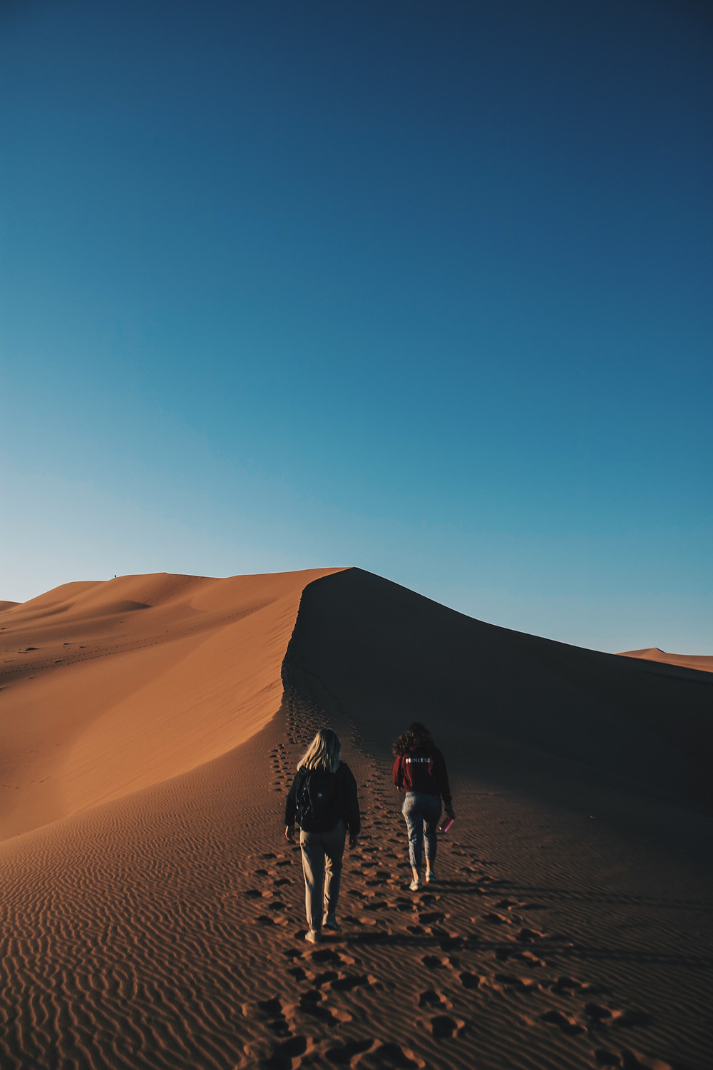 Two girls in Namibia desert