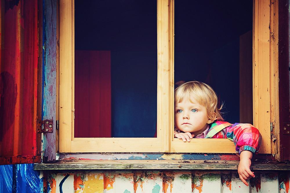 "Child staring out of a window. Photo by <a href=""https://unsplash.com/@wenutius?utm_source=unsplash&utm_medium=referral&utm_content=creditCopyText"">Joel Overbeck</a> on <a href=""https://unsplash.com/s/photos/open?utm_source=unsplash&utm_medium=referral&utm_content=creditCopyText"">Unsplash</a>"