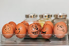 Six eggs with faces drawn on