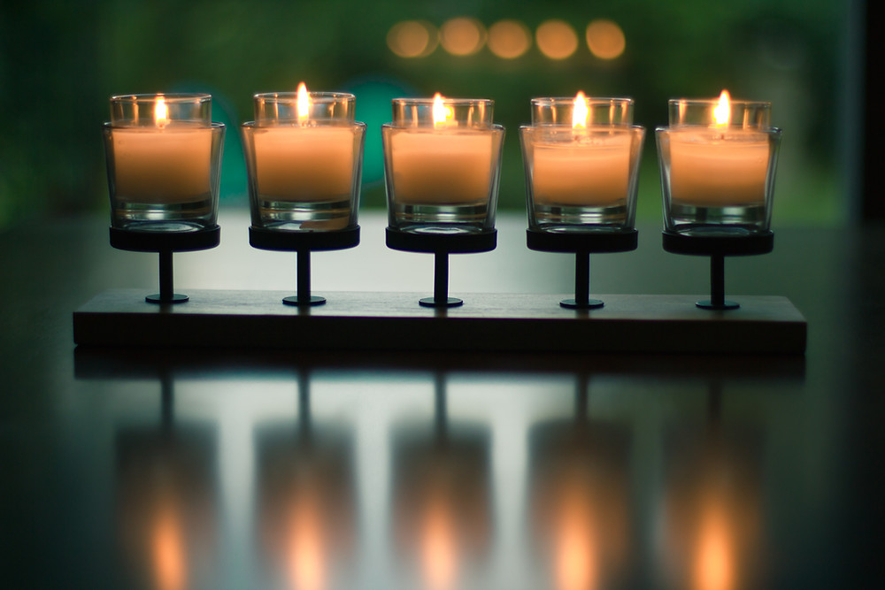 five lit candles