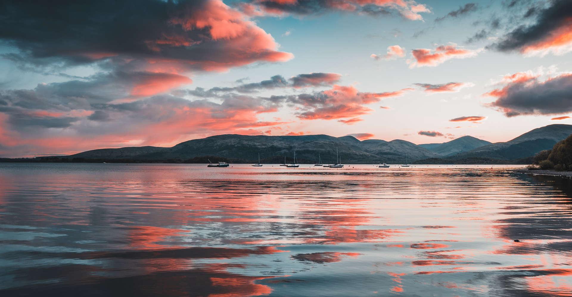 loch at sunset in scotland