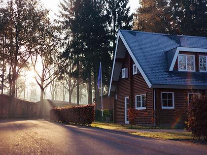 House in neighborhood at sunset