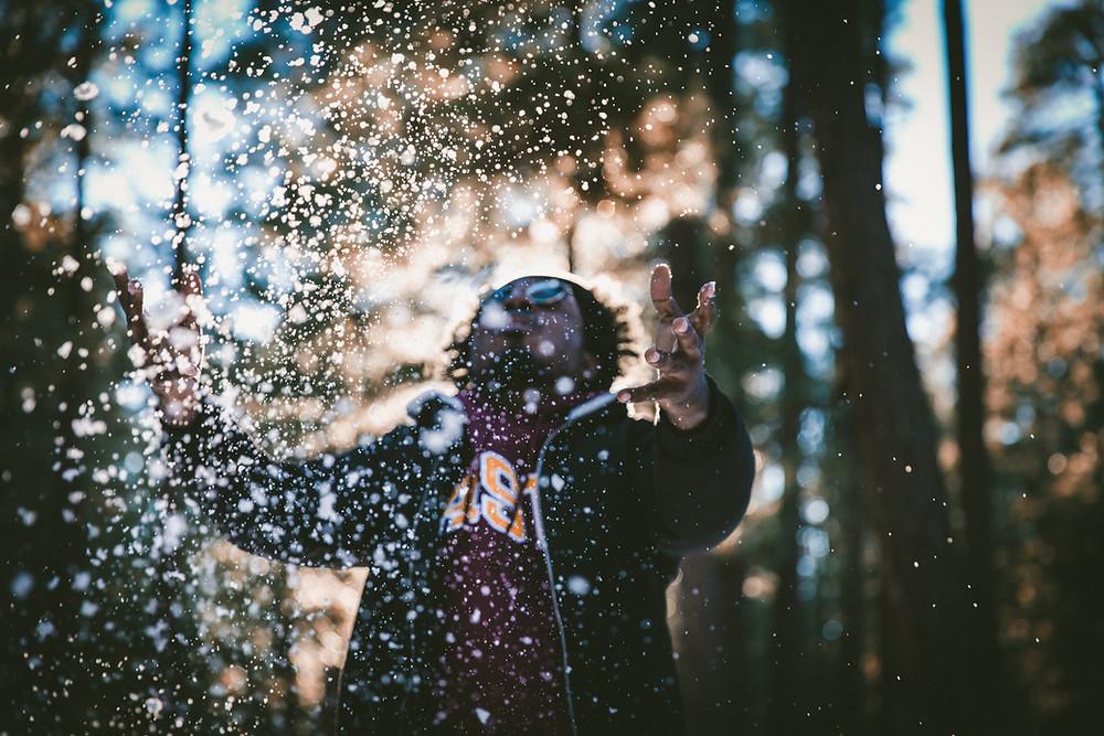 man outside in snow
