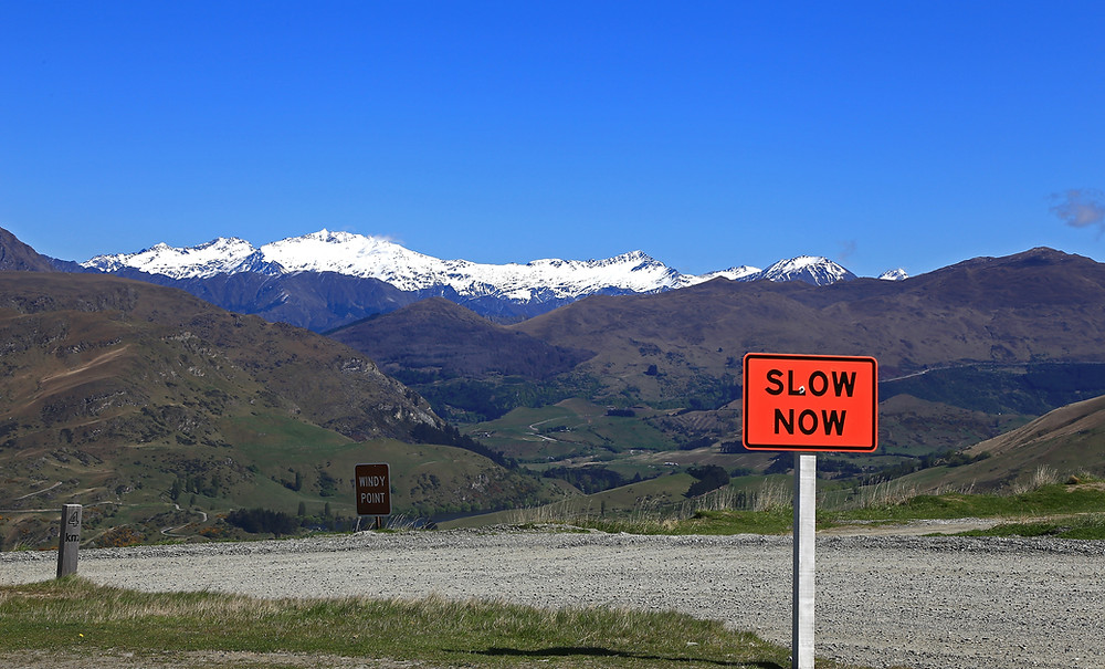 Pleasanton living trust attorney shows caution with slow down sign