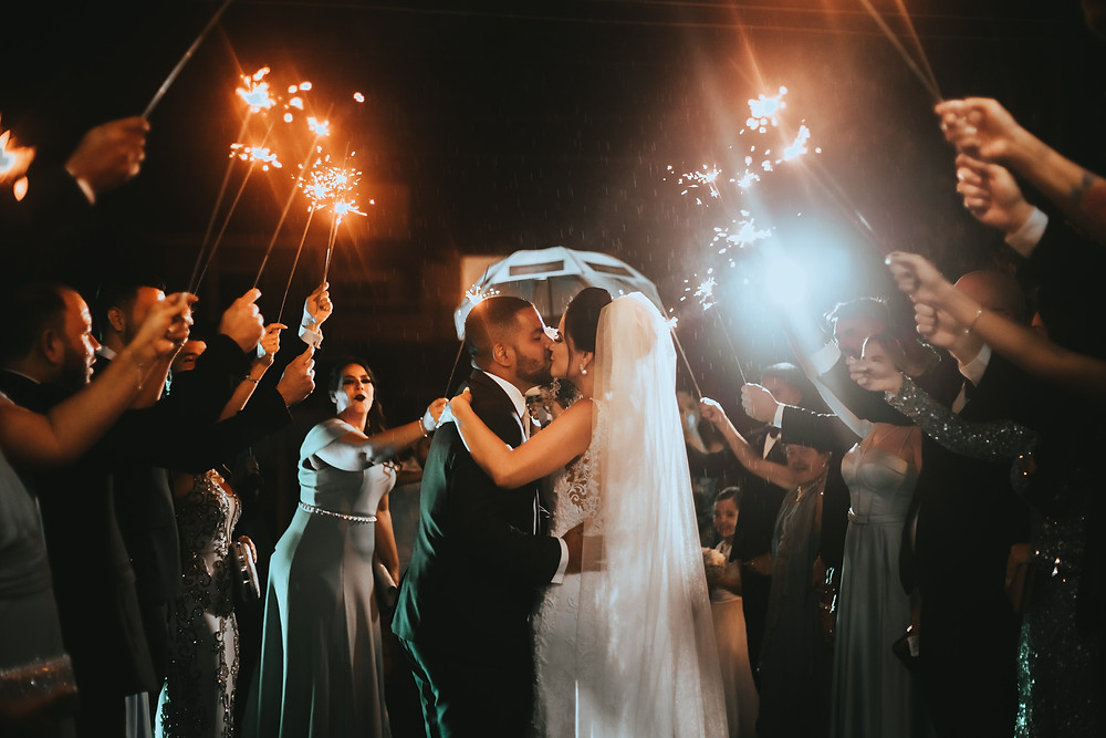 Wedding dance couple between their guests with sparklers