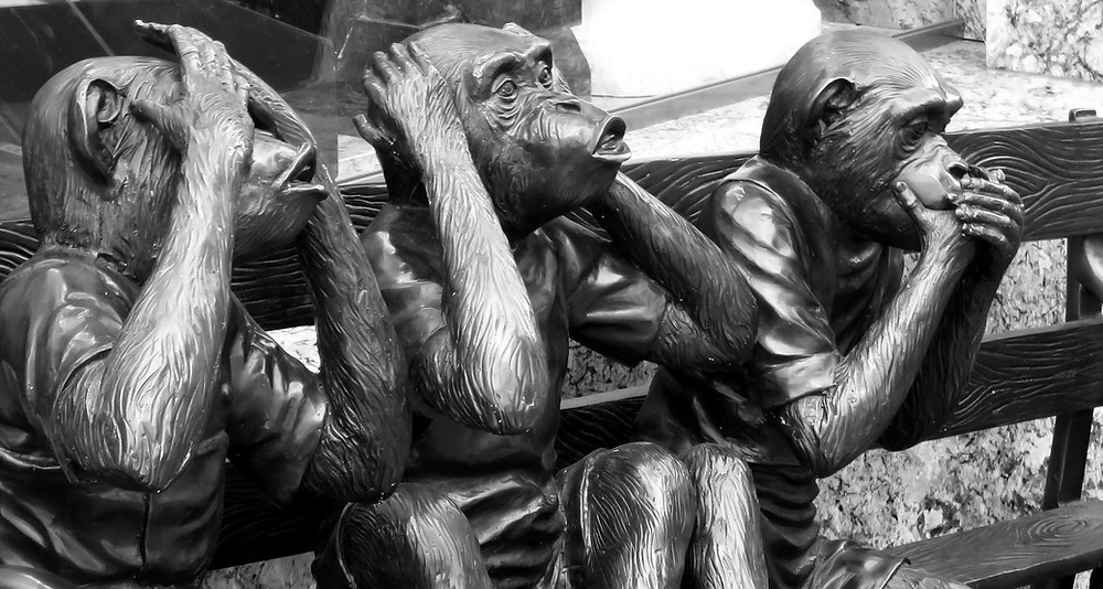 A sculpture of three monkeys, see no evil,  hear not evil
