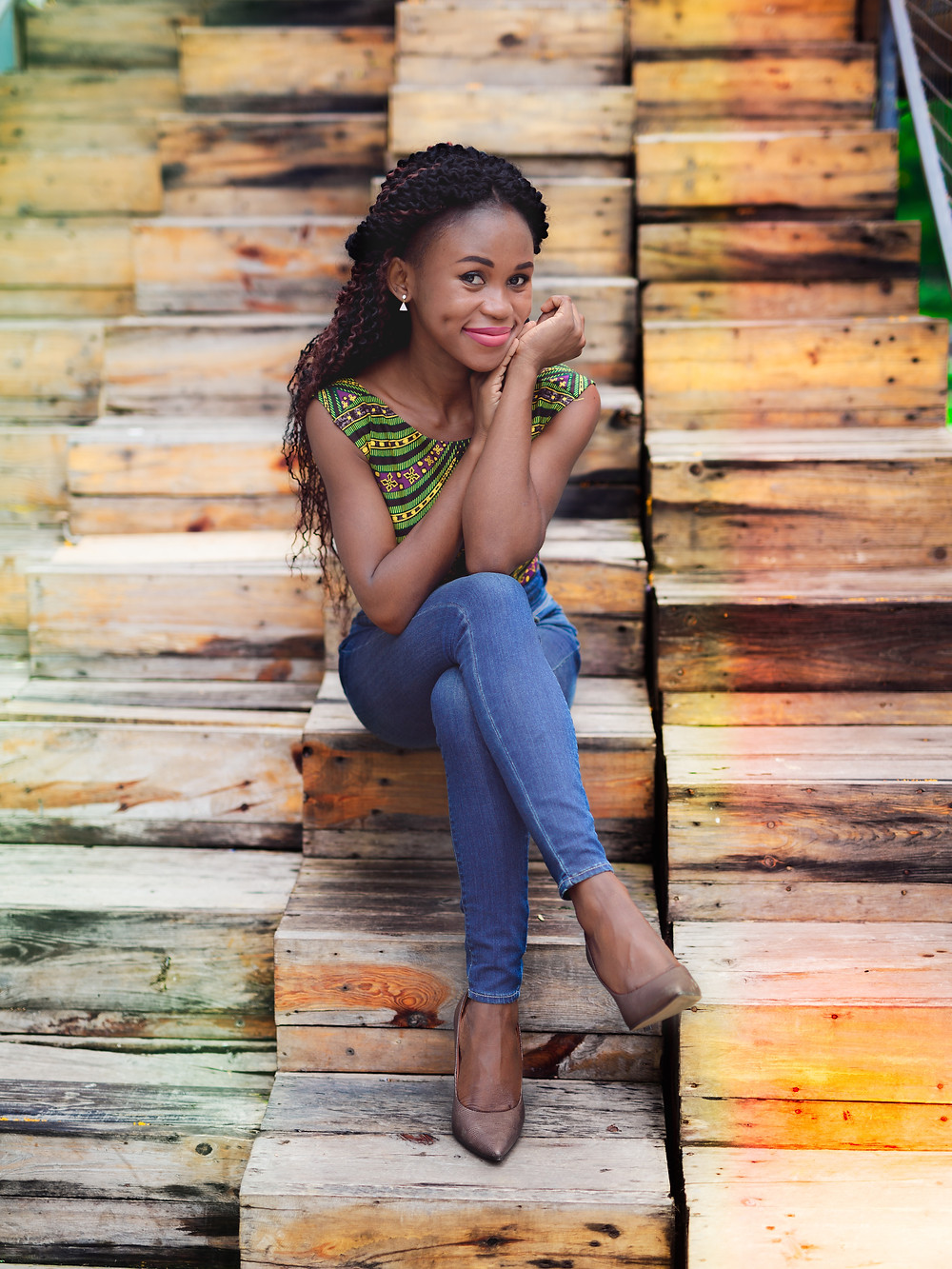 stylish woman wearing perfect jeans and heels sitting down