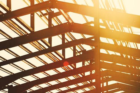 Orange light steel beams Image by Dakota Roos