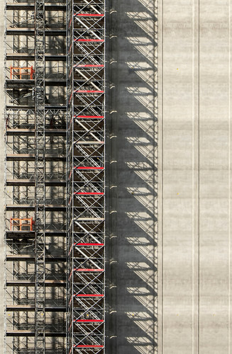 construction-site-of-multi-storey-concrete-wall-covered-with-scaffolding