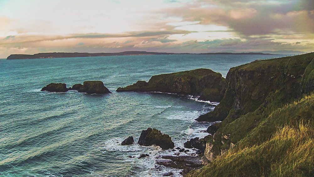 Cliff face and rocks in sea at Rathlin Island off the coast of Northern Ireland.