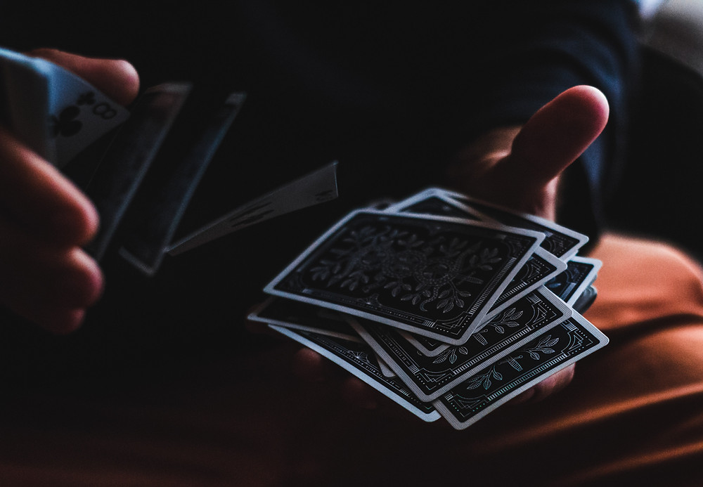 Tarot reader shuffling a deck of cards tips for new tarot readers and psychics daily magic