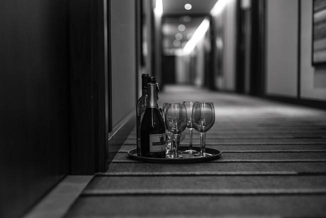 Wine bottle and glasses on floor