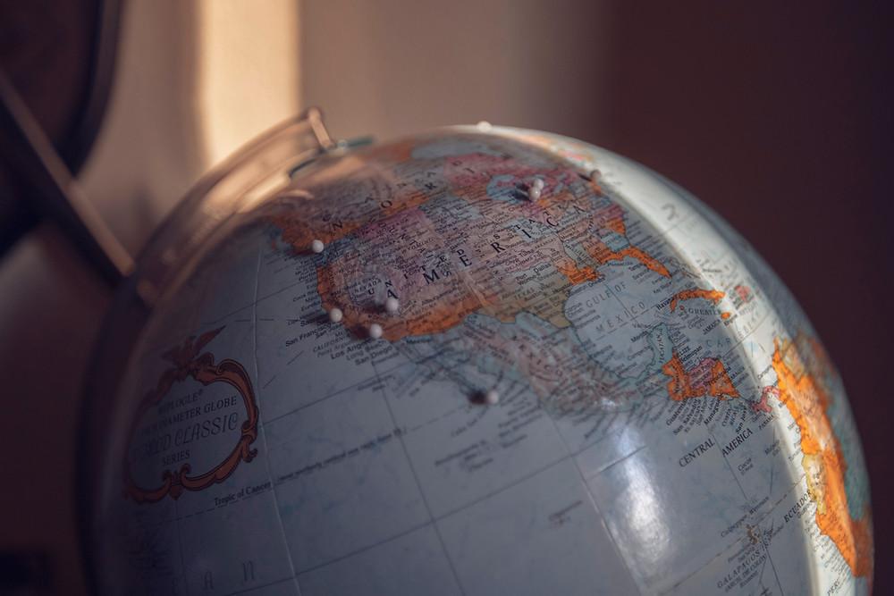 World globe with pins
