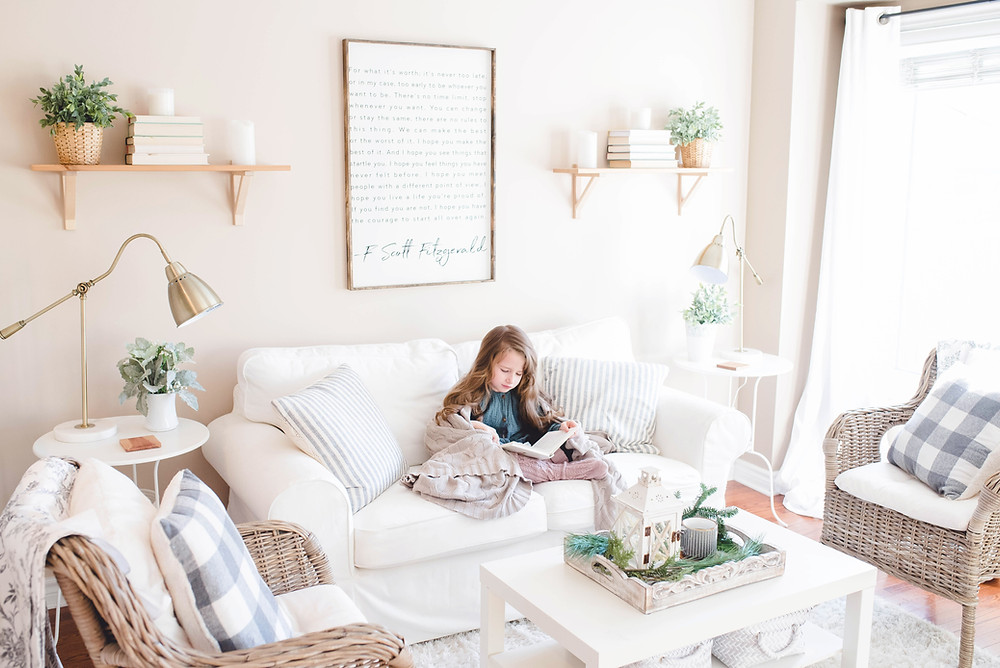 child reading book in coop living room