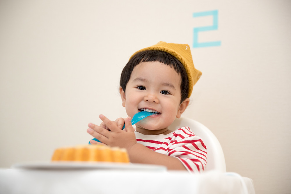 child smiling in high chair