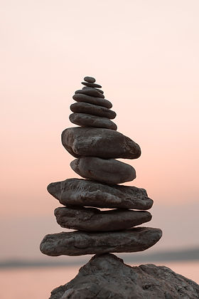 Rocks stacking on top of one another providing a sense of grounding of energy