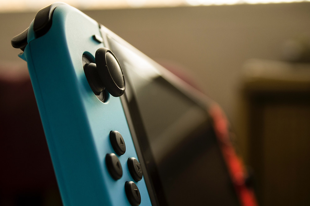 A lateral shot of the Nintendo Switch, without a dock.
