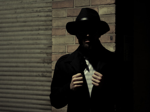 Who Is This Black Shadow Hat Man & What Does He Want?