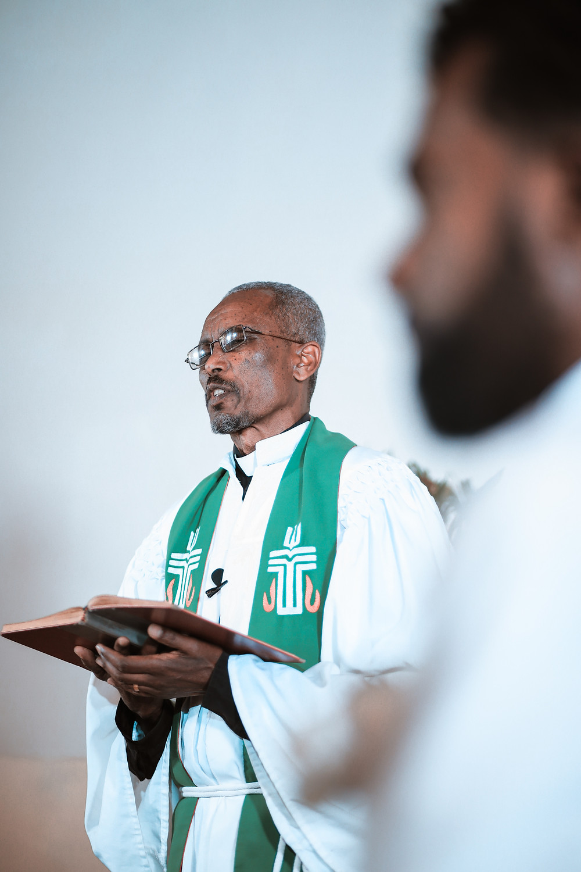 Pastor reading to believers