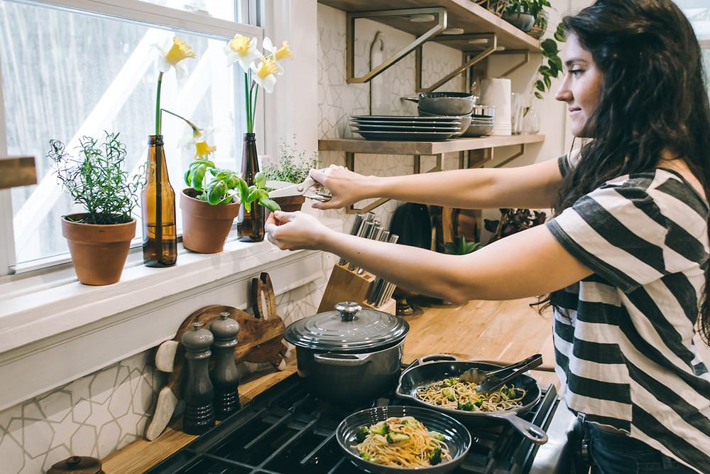 young woman cooking pasta amateur cook chef