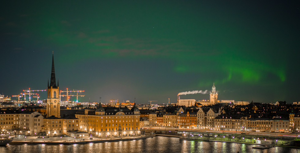 auroura over swedish town