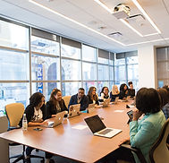 A diverse group of women in a meeting symbolizing career