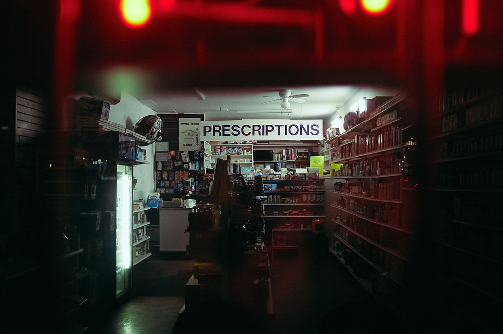 The prescription counter at the back of a drug store.