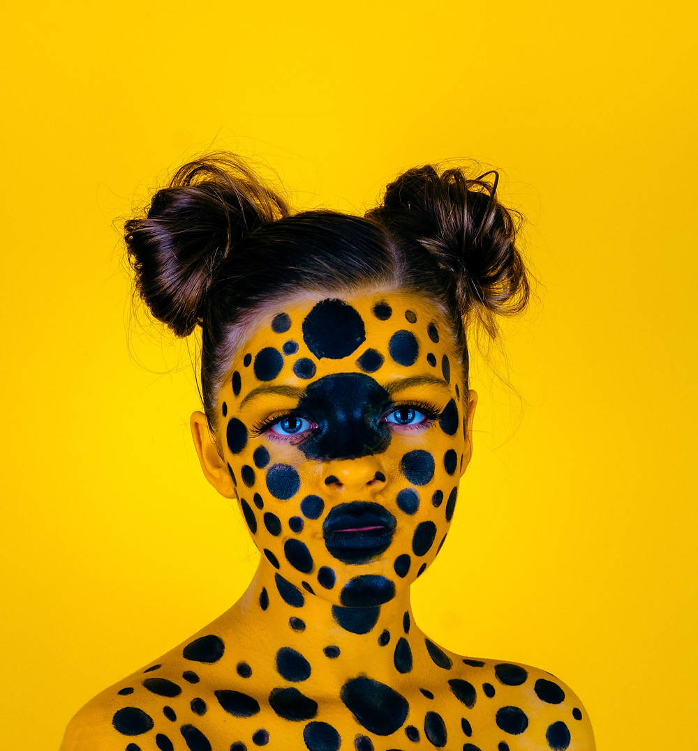 girl in disguise yellow and black spots
