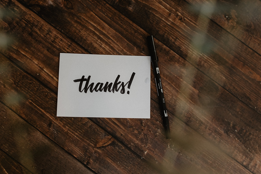 thank you note with a marker