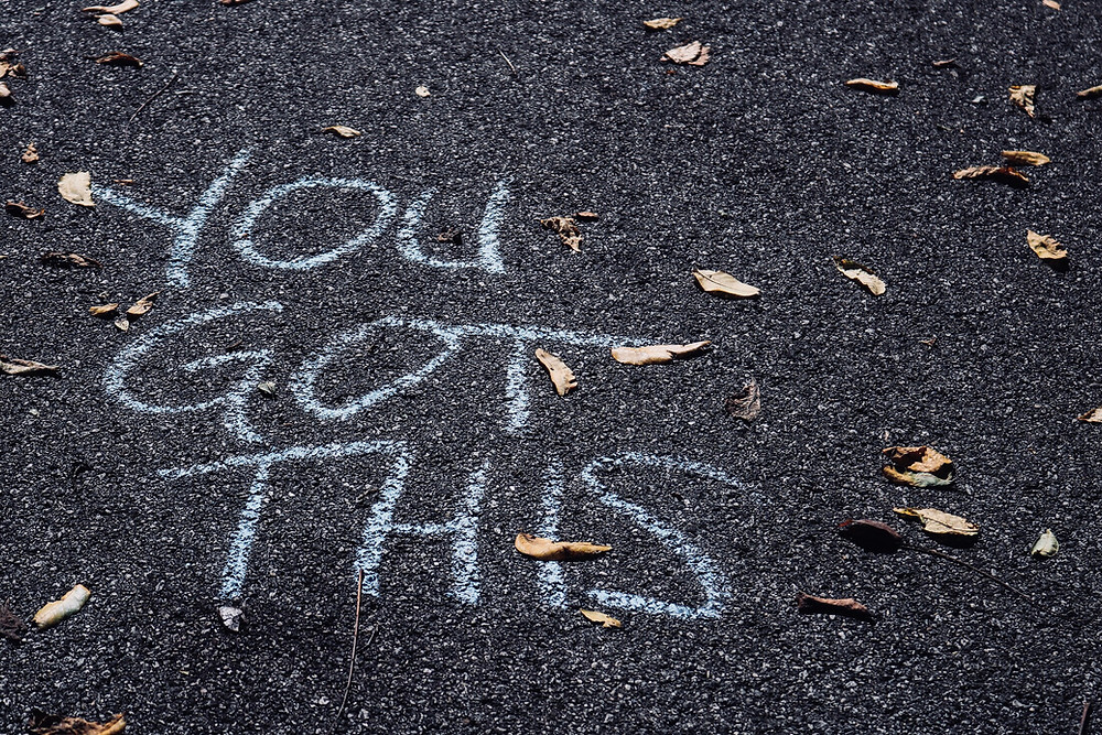 chalk writing on pavement saying 'you got this'