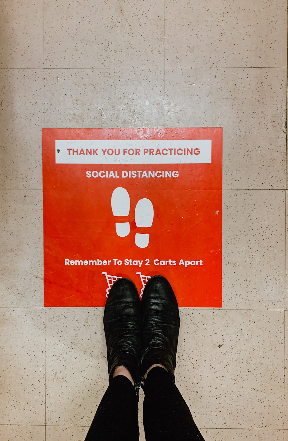 Social distancing sign on the floor of a store