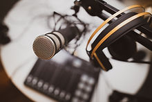 Headphones and microphone on stand