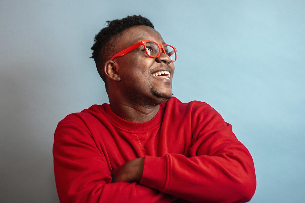 "alt=""Black man smiling after interview success using FAC3UK"">"