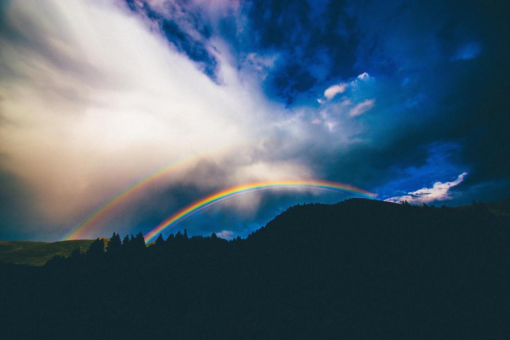 double rainbow on horizon