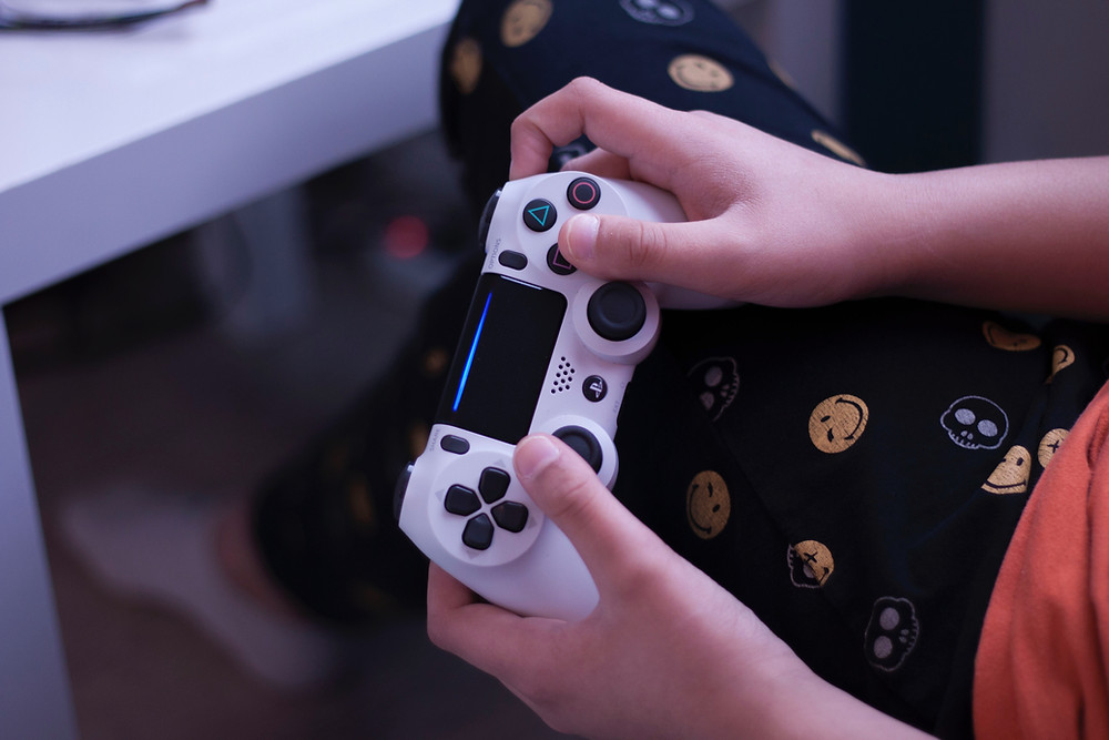 Child holding a PlayStation controller
