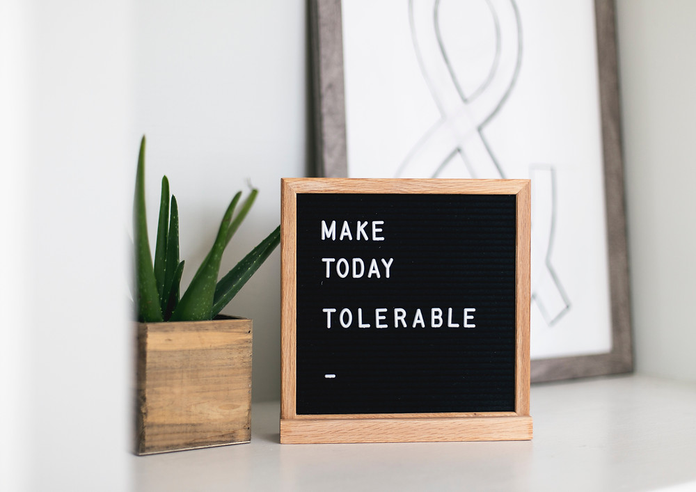 Sign saying 'make today tolerable'