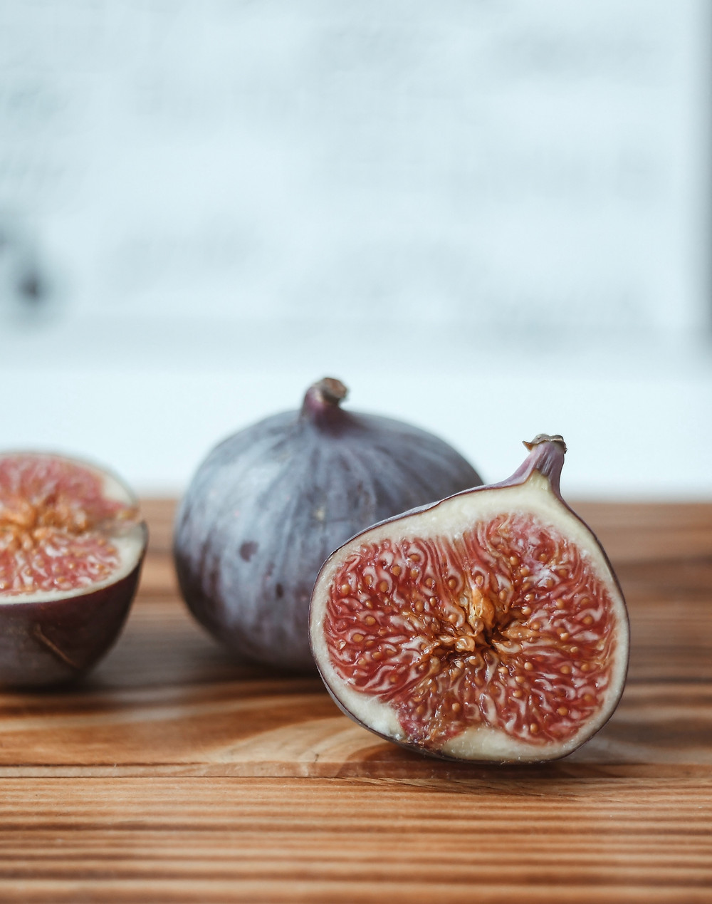 figs cut open and on a table