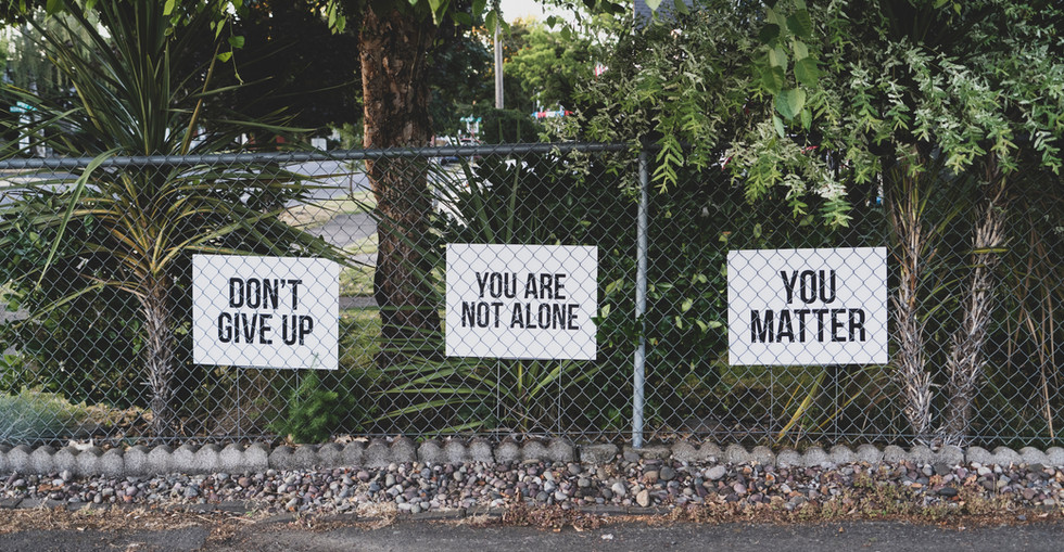 Fence outside of addiction clinic with inspirational quotes