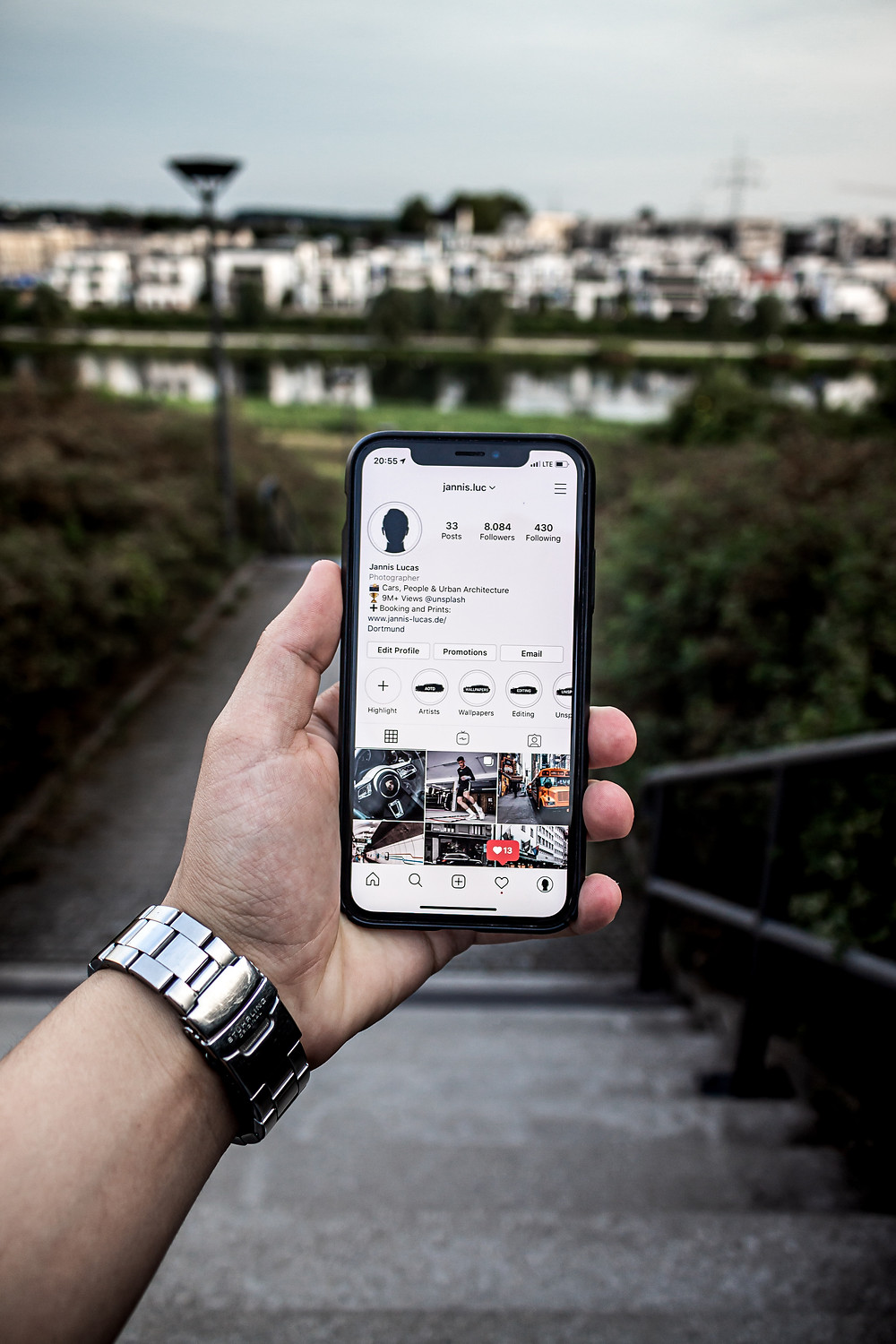 Man showing instagram account on mobile phone