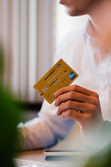 Woman holding credit card in her hand.
