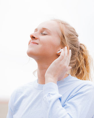 Woman with in-ear headphones