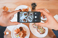 taking a picture of food at a restaurant