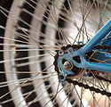 Image of bicycle spokes by Chepe Nicoli