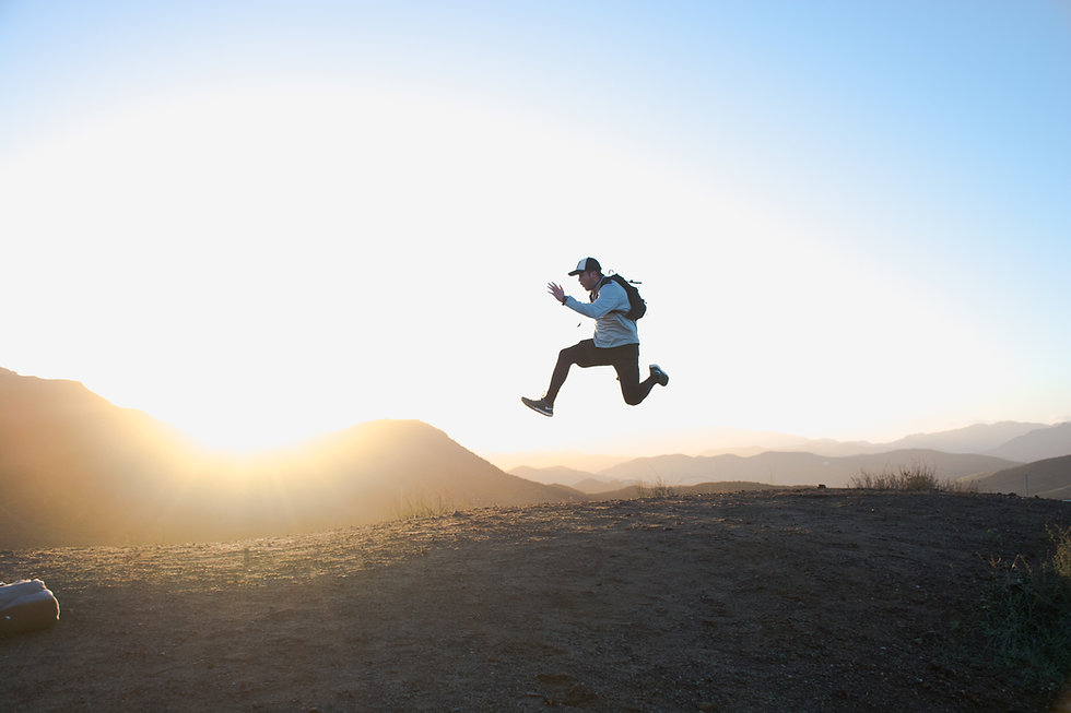 Man jumping to debt freedom with sunny background