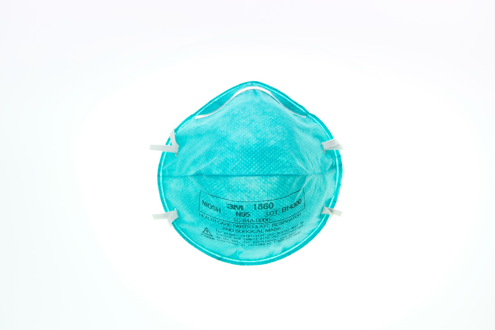 A turquoise mask with white background