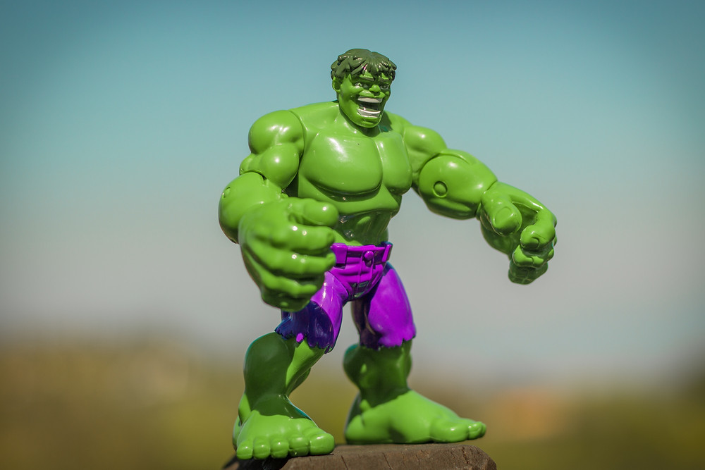 Small plastic green muscle-bound Incredible hulk